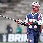 Kyle Sweeney #77 of the Boston Cannons looks to pass the ball during the game at Harvard Stadium on April 27, 2014 in Boston, Massachusetts. (Photo by Elan Kawesch)