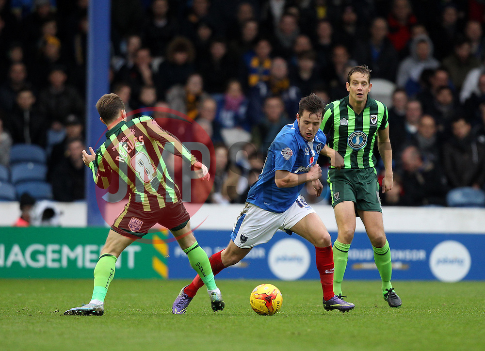 Marc McNulty of Portsmouth takes on Jake Reeves of AFC Wimbledon - Mandatory byline: Robbie Stephenson/JMP - 07966 386802 - 15/11/2015 - Rugby - Fratton Park - Portsmouth, England - Portsmouth v AFC Wimbledon - Sky Bet League Two