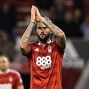 Nottingham Forest midfielder Henri Lansbury (10) applauds the Forest fans during the EFL Sky Bet Championship match between Nottingham Forest and Birmingham City at the City Ground, Nottingham, England on 14 October 2016. Photo by Jon Hobley.