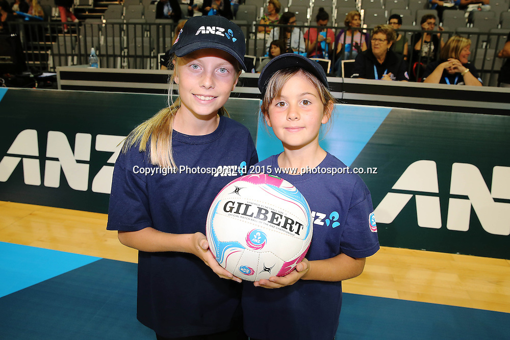 ANZ Future Captains Heather Kibby aged 13 (L) and Natalie Barclay aged 8 (R). 2015 ANZ Championship, Waikato Bay of Plenty Magic v Canterbury Tactix, Claudelands Arena, Hamilton, New Zealand. Photo: Anthony Au-Yeung / www.photosport.co.nz