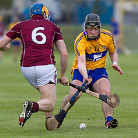 Clare's Nicky O'Connell and Galway's Paul Killeen clash the ash