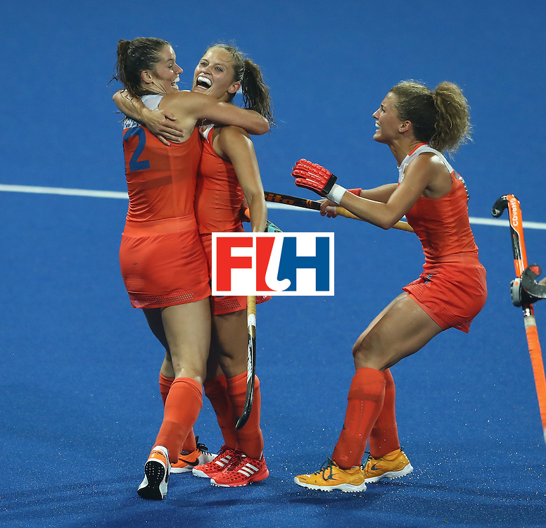 RIO DE JANEIRO, BRAZIL - AUGUST 15:  Kelly Jonker (C) of the Netherlands celebrates with team mates after scoring their third goal during the Women's quarter final hockey match between the Netherlands and Argentina on Day10 of the Rio 2016 Olympic Games held at the Olympic Hockey Centre on August 15, 2016 in Rio de Janeiro, Brazil.  (Photo by David Rogers/Getty Images)