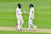 Hashim Amla of Hampshire and Liam Dawson of Hampshire touch gloves during the Specsavers County Champ Div 1 match between Hampshire County Cricket Club and Worcestershire County Cricket Club at the Ageas Bowl, Southampton, United Kingdom on 13 April 2018. Picture by Graham Hunt.