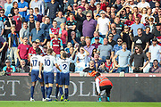 Tottenham Hotspur midfielder Erik Lamela (11) celebrates with teammates after scoring the first goal of the match during the Premier League match between West Ham United and Tottenham Hotspur at the London Stadium, London, England on 20 October 2018.