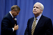 Sen. John McCain (R) listens to a question as Sen. Lindsay Graham  (L) looks on during a health care town hall meeting September 14, 2009 at the Citadel in Charleston, SC.