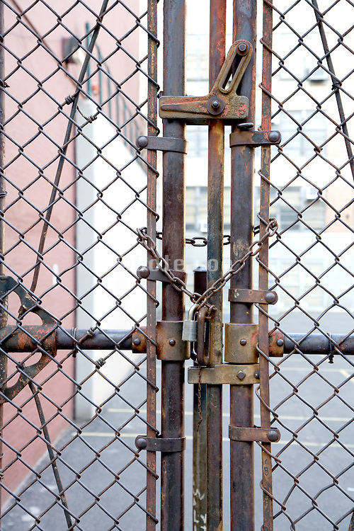 padlocked gate in metal fence