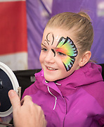 Little girl looking in the mirror at face painting at the Thousand Springs Art Festival at Ritter Island near Hagerman, Idaho. MR