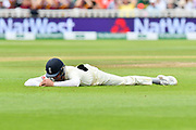 Dawid Malan of England lays on the ground after dropping a catch during second day of the Specsavers International Test Match 2018 match between England and India at Edgbaston, Birmingham, United Kingdom on 2 August 2018. Picture by Graham Hunt.