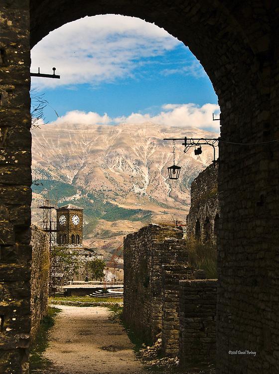 Stone arch Gjirokastra castle view clock tower