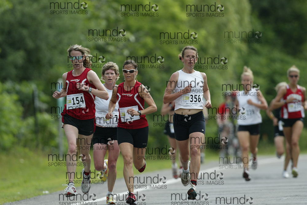 (Ottawa, Ontario---20/06/09)    SARAH DILLABOUGH (154);   PAULA WILTSE (2);   AMY SCHNEEBERG (356)\ competing in the 2009 edition of Emilie's Run 5km race for women in Ottawa. Copyright photograph Sean Burges / Mundo Sport Images, 2009. www.mundosportimages.com / www.msievents.