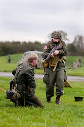 A member of the 101st Airborne, with a Thompson sub machine-gun, takes a German prisoner, from the Gross Deutschland Division, during a Northern World War Two association large scale battle reenactment at Pickering 1940s war weekend 16th-18th October 2009 Image Copyright Paul David Drabble