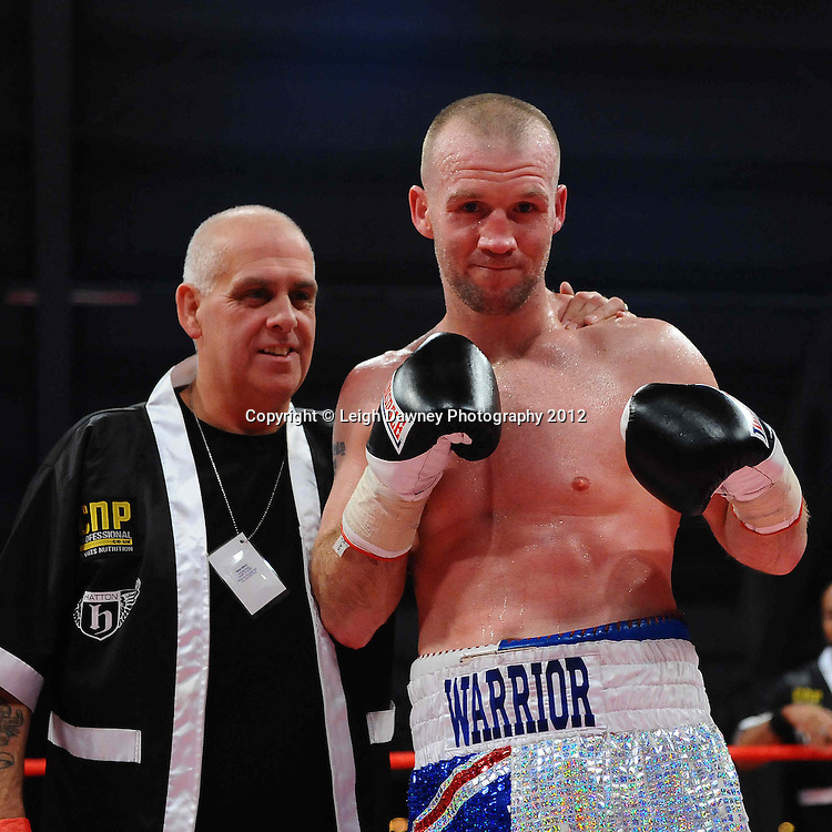 Tony Dodson (with trainer) defeats John Anthony defeats Kirk Goodings in a 6x3 Super Middleweight contest on the 30th November 2012 at Aintree Equestrian Centre, Aintree, Liverpool. Frank Maloney Promotions. Pictures by Leigh Dawney. ©leighdawneyphotography 2012.