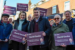 © Licensed to London News Pictures. 18/11/2019. RICKMANSWORTH, UK.  Former Justice Secretary David Gauke (C) campaigns in Rickmansworth as an independent candidate to be the MP of South West Hertfordshire, the seat he has held since 2005.  Offering support to him on the general election campaign trail is former Home Secretary Amber Rudd (4L), who has announced she will not be standing as an MP.  Photo credit: Stephen Chung/LNP
