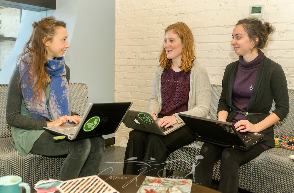 Eileen Schaeffer, Lexie Lipham, and Erin Luce, of the AmeriCorps VISTA Urban Green Lab, hold a business meeting at the Nashville Entrepreneur Center, Jan. 6, 2015, in Nashville, Tenn. The Entrepreneur Center has become the nucleus of a burgeoning startup movement — largely led by Millennials — in the city. (Photo by Carmen K. Sisson/Cloudybright)