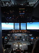 He's flying without wings! Father builds Boeing 737 cockpit in his son's bedroom<br /> <br /> While many air-plane enthusiasts are content to keep their hobby confined to shows or miniature models, for one man this was simply not enough.<br /> <br /> A French father has instead taken his obsession to an extraordinary level - by building a Boeing 737 flight simulator in his son's room.<br /> <br /> Laurent Aigon has spent five years lovingly replicating the inside of a cockpit in the bedroom - forcing his son to sleep on a bed crammed into the corner of the room.<br /> The 40-year-old, from Lacanau in south-western France, has meticulously collected the pieces to build the simulator, which makes the user feel like they are thousands of feet up in the air, the Metro reported.<br /> Mr Aigon is a waiter who has always aspired to be a pilot - and now he has made his dream come true with the simulator.<br /> Such is the quality of his work that he was invited to lecture at the Institute of Aircraft Maintenance at Bordeaux-Merignac, which also used his simulator to train its students, Gizmodo reported. <br /> <br /> He has installed monitors to simulate flights to Brazil and Australia - although it is unclear whether he has managed to convince anyone to act as an air hostess to bring him refreshments on his long-haul 'journeys'.<br /> He is estimated to have spent thousands of euros on his passion, buying expensive parts so he can produce a lifelike version of the inside of the plane.<br /> The father chose a popular model to recreate, as the 737 series is the best-selling jet airliner in the history of aviation.<br /> The 737 has been continuously manufactured by Boeing since 1967, it was reported. <br /> And he has, in his own unique way, contributed to the traffic in the sky as there are, on average, 1,250 Boeing 737s airborne at any given moment, with two departing or landing somewhere every five seconds, it is estimated.<br /> ©Gizmodo/Exclusivepix