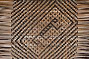 Macushi people &weaving split vine<br /> Yupukari village<br /> Savannah, Rupununi<br /> GUYANA<br /> South America