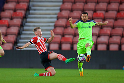 SOUTHAMPTON, ENGLAND - Monday, April 10, 2017: Southampton's Callum Slattery in action against Liverpool's Kevin Stewart during FA Premier League 2 Division 1 Under-23 match at St.Mary's Stadium. (Pic by David Rawcliffe/Propaganda)