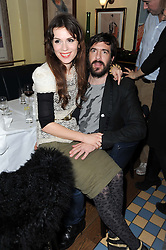 LARA BOHINC and her husband  at a cabaret evening at Bellamy's, Bruton Place, London on 22nd March 2010.