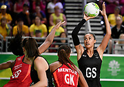 11th April 2018, Gold Coast Convention and Exhibition Centre, Gold Coast, Australia; Commonwealth Games day 7; Netball, England versus New Zealand; Maria Folau of New Zealand prepares to shoot for goal as Eboni Beckford-Chambers of England blocks