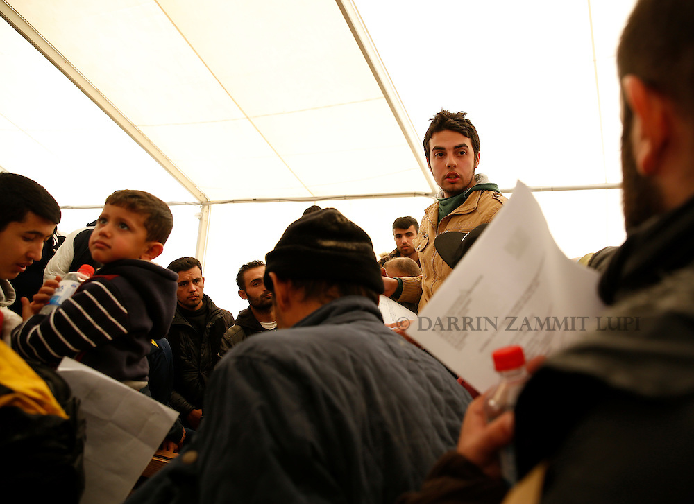 Refugees and migrants receive their documents enabling them to continue their journey towards western Europe from the Macedonia-Greece border at the Vinojug Temporary Transit Centre outside the village of Gevgelija, Macedonia, February 1, 2016.<br /> Photo: Darrin Zammit Lupi