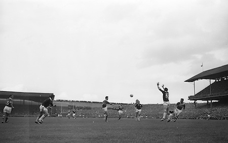 All Ireland Senior Football Championship Final, Kerry v Galway, 27.09.1964, 09.27.1964, 27th September 1964, Galway 0-15 Kerry 0-10, 27091964AISFCF,.P. Griffin, Kerry forward kicks the ball left-footed over the bar to score Kerrys first point. N. Tierney Galway full abck jumps ut fails to stop the ball, also shown righht is T.Long ....Referee J Hatton (Wicklow).Captain J Donnellan,.Attendance: 76,498,