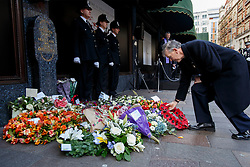 © licensed to London News Pictures. London, UK 17/12/2013. Friends and family of victims lay wreaths to commemorate an IRA bomb attack on Harrods which killed six people, including three Metropolitan Police officers on December 17, 1983. The 30th anniversary is marked by members of Metropolitan Police, relatives and friends of victims and Harrods staff at a special service outside the world-famous department store in London on Tuesday, December 17, 2013. Photo credit: Tolga Akmen/LNP
