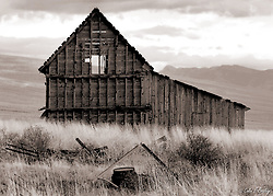 A circa 1800's barn sits on a hillside field in northern Utah. Colin E. Braley/Wild West-Media