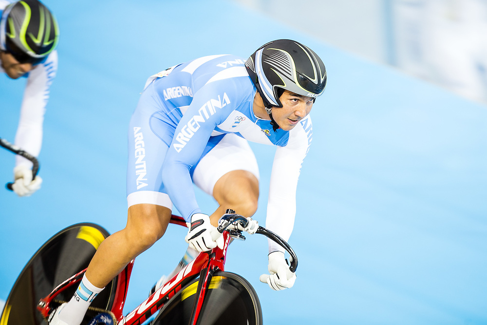 Leandro Bottasso of Argentina leads his teammates during the men's team sprint qualification on the fist day of track cycling at the 2015 Pan American Games in Toronto, Canada, July 16,  2015.  AFP PHOTO/GEOFF ROBINS
