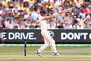 Alastair Cook plays a hook shot for four which brings up his 150 during day three of the Australia v England fourth test at the Melbourne Cricket Ground, Melbourne, Australia on 28 December 2017. Photo by Mark  Witte.