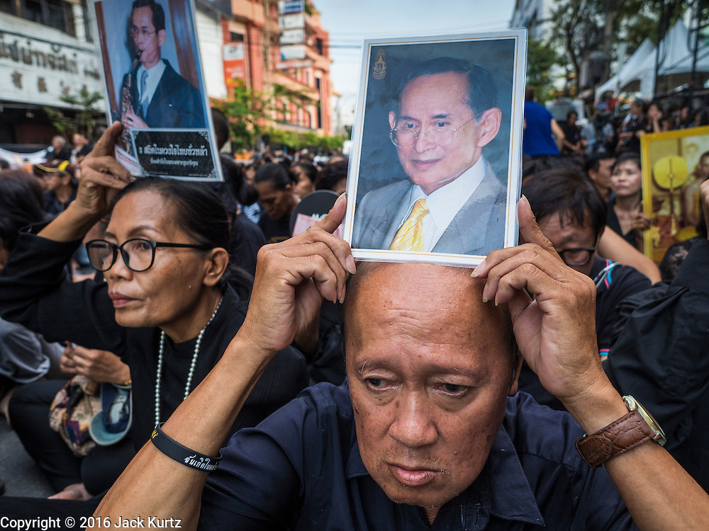 26 NOVEMBER 2016 - BANGKOK, THAILAND:  People gather on Yaowarat Road to honor the Late King of Thailand. Thousands of people gathered in the heart of Bangkok's Chinatown to honor Bhumibol Adulyadej, the Late King of Thailand. The event was organized by the Thai-Chinese community and included a performance by the Royal Thai Navy orchestra of music composed by the Late King, a prayer by hundreds of Buddhist monks. It concluded with a candlelight vigil. The King died after a long hospitalization on October 13. The government has declared a one year mourning period. HRH Crown Prince Maha Vajiralongkorn, the Heir Apparent and Late King's son, is expected to be name the King next week. He will be known as Rama X.      PHOTO BY JACK KURTZ