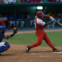 15 February 2009: Alexei Bell of the Orientales makes contact during a training game of Cuba Baseball Team for the World Baseball Classic 2009. The national team is pitted against itself, divided in two teams called the Occidentales and the Orientales. The Orientales win 12-8, at the Latinoamericano stadium, in la Habana, Cuba.