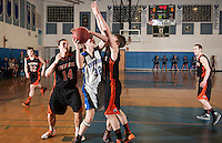 Winnisquam versus Farmington NHIAA Division III basketball tournament action.  Karen Bobotas/for the Concord Monitor