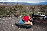 A camper sleeps in Death Valley National Park.