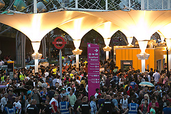 © Licensed to London News Pictures.27/07/2012 LONDON UK. Crowds gather outside stratford Station after Westfield Shopping centre is was closed to the public, during the opening Ceremony of the London 2012 Olympic Games. Photo credit : Andrew Baker/LNP