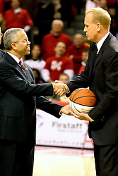 03 February 2007: Doug Collins accepts a ball from Illinois State University President Al Bowman during the pre-game ceremony naming the court in Redbird Arena Doug Collins Court.  Collins is regarded as the most prolific student athlete to ever attend Illinois State University. In what is locally referred to as the War on Seventy Four, the Bradley Braves defeated the Illinois State University Redbirds 70-62 on Doug Collins Court inside Redbird Arena in Normal Illinois.