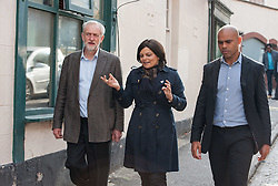© Licensed to London News Pictures. 15/10/2015. Bristol, UK.  JEREMY CORBYN, leader of the Labour Party, visits shops in Picton Street, Montpelier, Bristol, with Labour's Bristol West MP Thangam Debbonaire (centre) and Labour Mayoral candidate Marvin Rees (right), following a rally for Labour Party members at the Trinity Centre in Bristol, to highlight and oppose the impact of the Government's changes to voter registration, expected to remove 1 million voters from the electoral roll by the end of the year. Photo credit : Simon Chapman/LNP