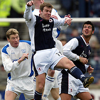 Raith Rovers v St Johnstone...10.04.04<br />Andy Dow is beaten by Mark Baxter<br /><br />Picture by Graeme Hart.<br />Copyright Perthshire Picture Agency<br />Tel: 01738 623350  Mobile: 07990 594431