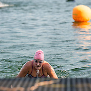 A swimmer fetch the first step to get out of Baie Saint-François