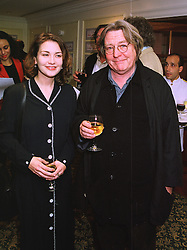 MISS LISA MORAN and MR ALAN PARKER the film director at an exhibition in London on 20th November 1997.MDO 10