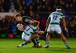 Dragons' Jack Dixon is tackled by Newcastle Falcons' Joel Hodgson<br /> <br /> Photographer Craig Thomas/Replay Images<br /> <br /> EPCR Champions Cup Round 4 - Newport Gwent Dragons v Newcastle Falcons - Friday 15th December 2017 - Rodney Parade - Newport<br /> <br /> World Copyright © 2017 Replay Images. All rights reserved. info@replayimages.co.uk - www.replayimages.co.uk