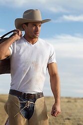 rugged good looking cowboy outdoors on a ranch in New Mexico