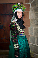 The bridesmaid, member of the 'Hessische Vereinigung f&uuml;r Tanz- und Trachtenpflege Fachgruppe Brauchtum und Trachten' is wearing an original traditional bridal costume in Marburg, Hesse, Germany on November12, 2016.<br /> <br /> This evangelical traditional costume is from around 1920. Marburg is one of the few areas in Germany where women still wear a traditional costume (around 80 nowadays).<br /> Only pristine women were allowed to wear the bridal crown.<br /> <br /> This is part of the series about Traditional Wedding Gowns from different regions of Germany, worn by young members of local dance groups and cultural associations that exist to preserve and celebrate the cultural heritage. The portraiture series is a depiction of an old era with different social values and religious beliefs in an antiquated civil society with very few of those dresses left. The bridesmaid Kathrin, member of the 'Hessische Vereinigung f&uuml;r Tanz- und Trachtenpflege Fachgruppe Brauchtum und Trachten' is wearing an original traditional bridal costume in Marburg, Hesse, Germany on November12, 2016.<br />