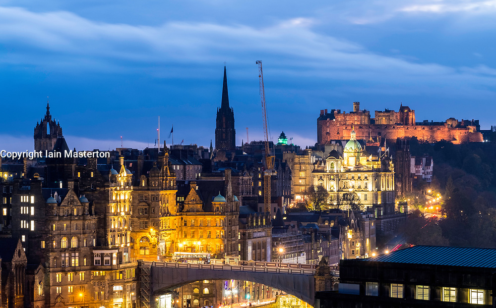 Night view towards Edinburgh Old Town , The Mound and Edinburgh Castle, Scotland, United Kingdom.