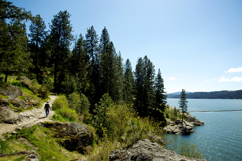 A hiker travels on the Tubbs Hill trail along the west side of the popular recreation area Tuesday, May 10, 2011 in downtown Coeur d'Alene.
