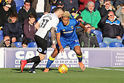 AFC Wimbledon striker Lyle Taylor (33) battles for possession with Peterborough United attacker Marcus Maddison (11) during the EFL Sky Bet League 1 match between AFC Wimbledon and Peterborough United at the Cherry Red Records Stadium, Kingston, England on 12 November 2017. Photo by Matthew Redman.