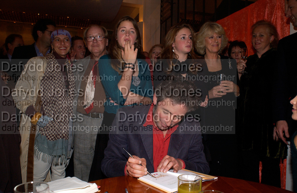 Lord and Lady McCalpine, Kitty and Elizabeth Rice behind their father Matthew Rice, Camilla Parker Bowles.  Tom Parker Bowles, Susan Hill and Matthew Rice host party to launch 'E is For Eating' Kensington Place. 3 November 2004.  ONE TIME USE ONLY - DO NOT ARCHIVE  © Copyright Photograph by Dafydd Jones 66 Stockwell Park Rd. London SW9 0DA Tel 020 7733 0108 www.dafjones.com