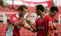 Photo: Leigh Quinnell.<br /> Swindon Town v Boston United. Coca Cola League 2. 30/09/2006. Swindons Andy Monkhouse(L) celebrates his goal with teammate Curtis Weston.