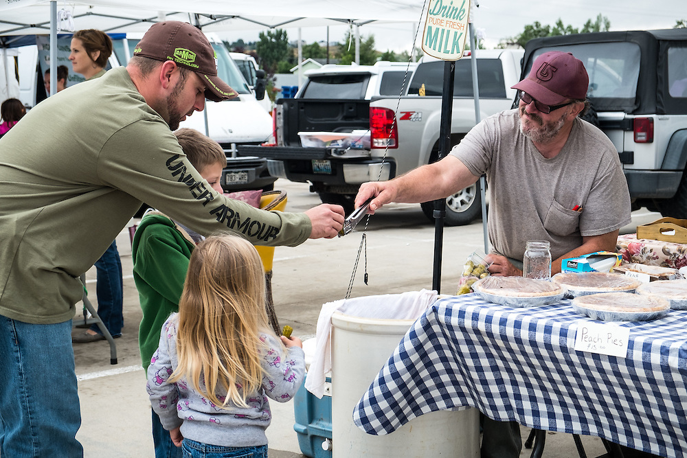 Frank Wallis hands out samples of his pickles at the Gillette Farmer's Market | August 23, 2014