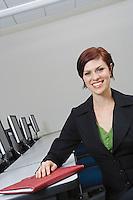 Cheerful Businesswoman Sitting at Desk Portrait