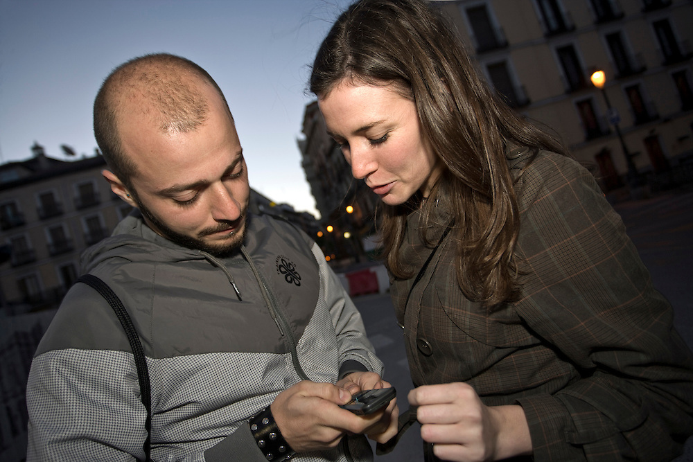 7:12 AM: Marco Fiordalisi, 26, and María Padín, 25, exchange phone numbers at Plaza de Ópera, after an exciting party night in Madrid.